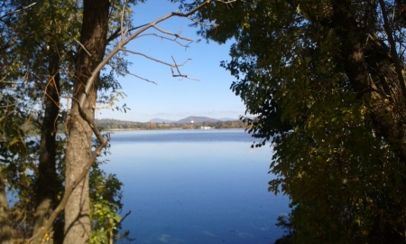Looking across Lake Burley Griffin from the footpath to the mountains beyond